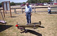 Name: Jim Schroeder and his P-40 Warhawk that he constructed from foam.jpg