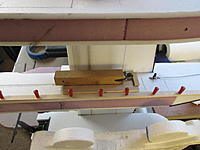 Name: Jeff's A-26 Nose Repair 3.jpg Views: 8 Size: 1.84 MB Description: I used the drill-in-drill trick to get pin-sized holes through the basswood bottom guide rail.