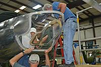 Name: DSC_0119_sm.jpg Views: 150 Size: 212.4 KB Description: Volunteers fitting a new plexiglass nose to an A-26.
