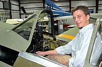 """Name: DSC_0137_sm.jpg Views: 157 Size: 224.7 KB Description: That's me in a P-47. I'm 6'3"""", but they have a really tall seat cushion in it."""