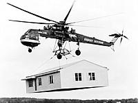 Name: Sikorsky_Skycrane_carrying_house_bw.jpg