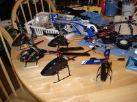 Name: DSC00442.jpg Views: 259 Size: 110.7 KB Description: Thought I would include this snapshot of some of my micro helis on my messy work area.