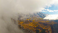Name: TimpClouds.jpg Views: 71 Size: 151.0 KB Description: Base of snowy Timpanogos through the clouds with fall-lit meadows at base.