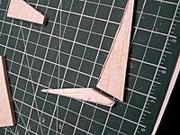 Name: 20121218_202430 (Medium).jpg Views: 236 Size: 185.3 KB Description: Cut two pieces for skeg, note grain direction