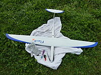Name: P1000776.jpg Views: 97 Size: 309.9 KB Description: Flash 2  Strong, one piece carbon wing. A little tricky to launch on my own, unless there is a good breeze blowing down the field...
