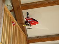 Name: P1030601.jpg Views: 36 Size: 97.5 KB Description: flying in the living room. Note tiny 1S LiPo suspended below