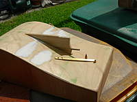 Name: DSCN7621.jpg Views: 353 Size: 62.8 KB Description: Notched out the skeg, layed out and drilled pilot holes for the rudder shoe.( I think that's what it's called)