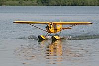 Name: floatfly3.jpg Views: 159 Size: 76.3 KB Description: Great Planes .60 size Cub from a kit. OS .91 four stroke. Ralph Smith's Plane Fun Floats