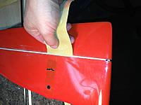 Name: Picture 005.jpg Views: 42 Size: 138.0 KB Description: sanding the wiper down carefully while apply pressure with the rudder in order to improve the available left rudder throw
