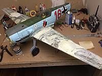 Name: Rebuild.jpg Views: 117 Size: 78.2 KB Description: Left wing grafted back on.  Gotta love foam!