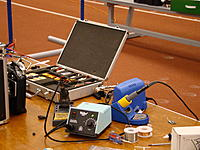 Name: DSC08693.jpg Views: 72 Size: 241.6 KB Description: Pit area was well stocked with chargers, spares, and repair materials.