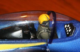 The pilot (not included) sits in the cockpit of the F/A-18 interior