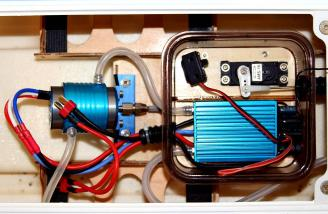 The brushless power system with the ESC's watertight lid removed