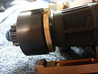 Name: 20141028_155004.jpg Views: 42 Size: 502.1 KB Description: This gap between the flywheel and engine case needs to be in the  1mm range or less for best results. It doesn't have to be this close but you will have to space your spur out more or it will rub the wall of the clutch bell