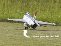 Name: nosegear.jpg Views: 992 Size: 54.2 KB Description: Here it is right before it cartwheeled in the deep grass. My friend was showing me I had the stick to the left but the nose gear was off the ground.