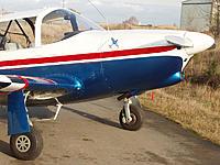 Name: ad3761kf.jpg Views: 121 Size: 181.3 KB Description: Mustang gear door, with hubcap
