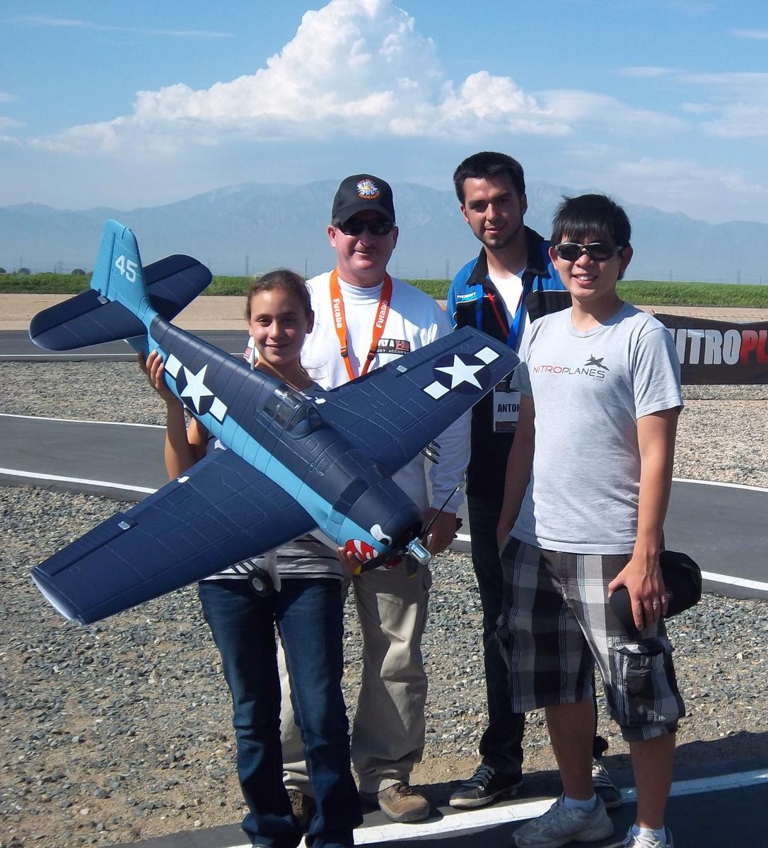 Name: Nitroplanes.jpg Views: 596 Size: 199.4 KB Description: Evelyn and I with Antonio and Tony from Nitroplanes. These guys are the best! They made us feel like part of the Nitroplanes family.