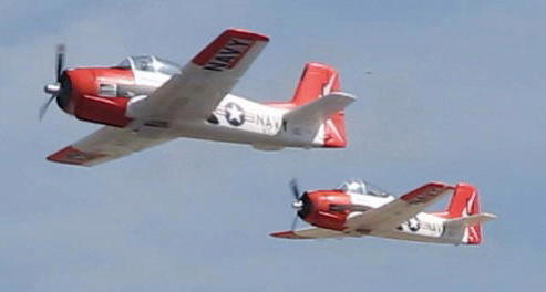 Name: MVI_1706__4.jpg Views: 241 Size: 13.5 KB Description: Antonio flying the T-28 (right and me (left) during the Noon Nitroplanes Demo. Photo by alpea41