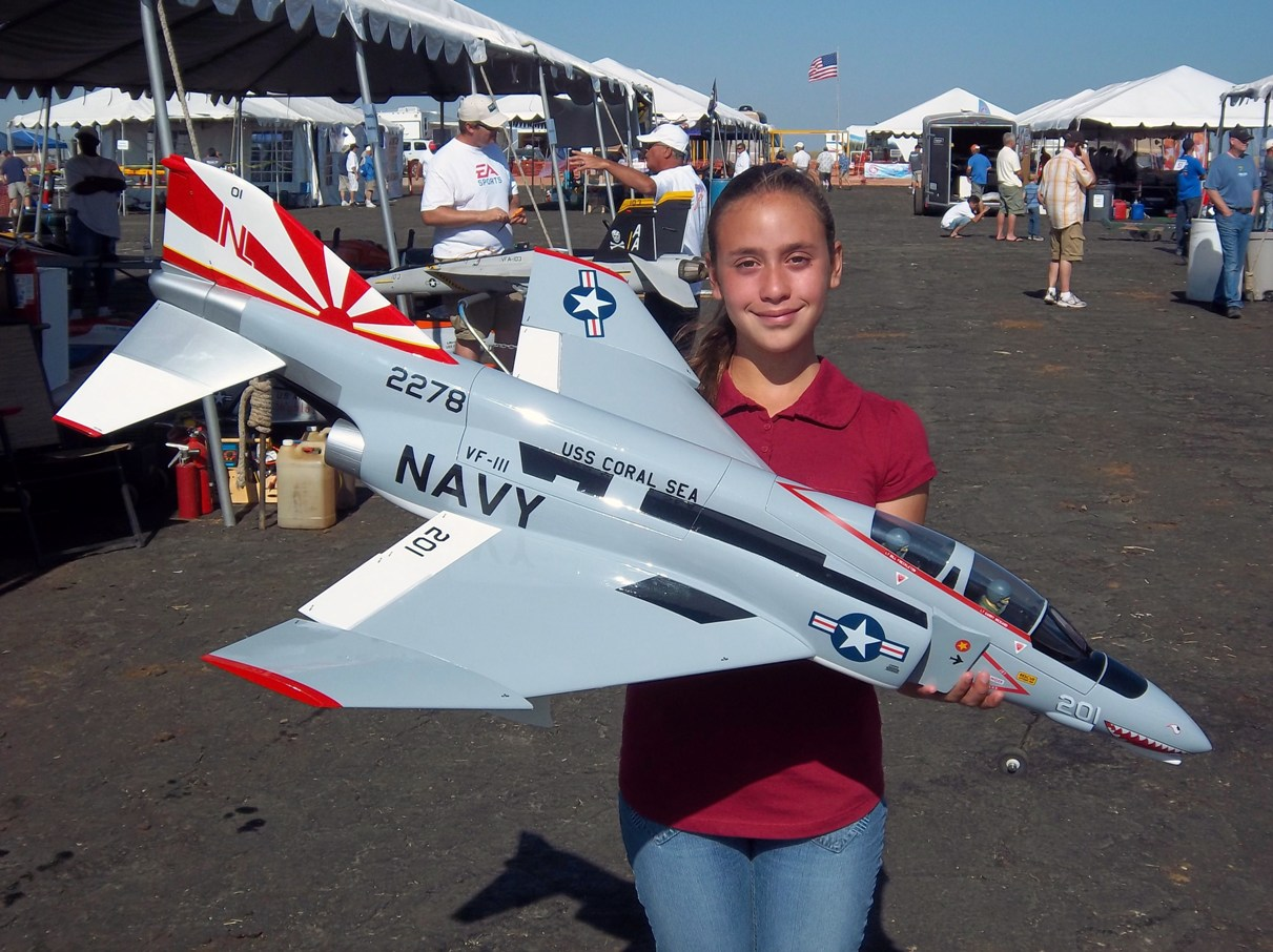 """Name: Evelyn & E-Flite F-4 1.jpg Views: 2,396 Size: 285.8 KB Description: My daughter, RC Pilot Evelyn holding the New E-Flite F-4 Phantom II at the """"Best of the West"""" Jet Rally in Buttonwillow, CA"""