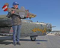Name: witchcraft.jpg Views: 81 Size: 855.7 KB Description: Pilot Evelyn holding the FlightlineRC B-24 Liberator, available from Motion RC.  Photo by Mike Gaasch
