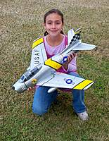 Name: F-86 Build 014.jpg Views: 328 Size: 139.6 KB Description: Evelyn holding her 50mm Blitz RC Works F-86 Sabre
