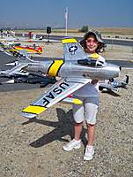 Name: Scale Masters 012.jpg Views: 717 Size: 132.7 KB Description: My daughter holding the new Banana Hobby 70mm EDF F-86 with Air Retracts, Flaps, Speed Brakes and Thrust Tube.