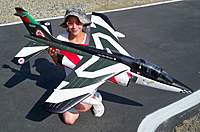 Name: Scale Masters 016.jpg Views: 276 Size: 81.6 KB Description: Evelyn holding the 90mm EDF Alpha Jet from Banana Hobby
