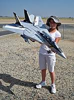 Name: Scale Masters 013.jpg Views: 380 Size: 138.0 KB Description: Evelyn holding the prototype twin 70mm EDF F-14 Tomcat from Banana Hobby.