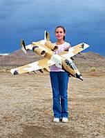 Name: Desert A-10 (19 Oct 10) 001.jpg Views: 238 Size: 113.2 KB Description: My daughter Evelyn holding the 64mm Desert Scheme A-10 from Banana Hobby