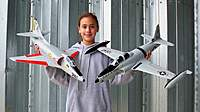 Name: 18 Dec 10 50mm T-33 & A-4 031.jpg Views: 504 Size: 71.1 KB Description: My daughter Evelyn, RC pilot holding the 50mm A-4 & T-33 from Toysonics.