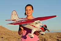 Name: Stinson Front.jpg Views: 725 Size: 154.7 KB Description: RC Pilot Evelyn holding the Parkzone Stinson Reliant SR-10 PnP.