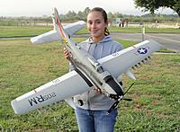 Name: Maiden Flight Day.jpg Views: 195 Size: 287.0 KB Description: RC Pilot Evelyn holding our new Durafly 1100mm A-1 Skyraider post maiden flight.