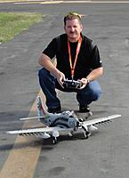 Name: Skyraider Successful Maiden.jpg Views: 142 Size: 118.7 KB Description: Tony with the Durafly 1100mm A-1 Skyraider after a successful maiden flight. Photo by Evelyn.