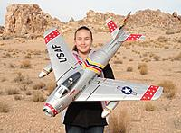 Name: 2 110.jpg Views: 58 Size: 278.9 KB Description: RC Pilot Evelyn holding the Starmax 70mm F-86 w/ E-Retracts from Hobby King