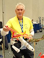 Name: AMA Expo 2013 076.jpg Views: 73 Size: 155.9 KB Description: Our friend Master Model Builder Don Butman showing off his stunning creations.