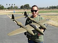 "Name: Jul 2013 088.jpg Views: 246 Size: 116.9 KB Description: RC Pilot Evelyn holding her restored Phase 3 P-38 ""Glacier Girl"""