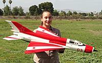 Name: DSC00474.jpg Views: 355 Size: 157.8 KB Description: RC Pilot Evelyn holding the HET Mig-21.