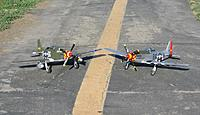 Name: IMG_3283.jpg Views: 125 Size: 252.3 KB Description: Brent Hecht's (Corsair Nut) Durafly P-51D Glamorous Glen III with Tony Accurso's (xplaneguy) Durafly P-51D Old Crow.
