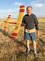 Name: IMG_9326.jpg Views: 72 Size: 324.2 KB Description: Stan Kelley with his 1/2A Sundancer. Back after 30 years away from free flight modeling. :)