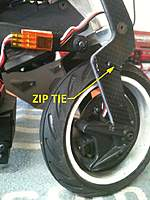 Name: sb5 brake 03.jpg Views: 697 Size: 91.6 KB Description: use zip tie to prevent servo wire from rubbing on the tire.