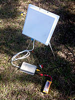 Name: pho4343to.jpg Views: 168 Size: 141.5 KB Description: Patch antenna and video RX hooked to a 3s lipo.