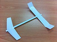 Name: 2f90b862-bec8-49b9-9bf4-1266b1e2616e.jpg Views: 64 Size: 49.1 KB Description: This is one of the best office-supply-rules planes because of it's very light weight. Since it's a canard, it's CG is perfect without adding any additional weight. It has a very slow flight with a very shallow glide slope.