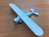 Name: 0bc1db15-ae3f-4f07-a457-f32062ddbd5f.jpg Views: 47 Size: 47.1 KB Description: This one breaks office-supply-rules by using glue. It's a prototype for a rubber-powered plane I'm building. Notice the paperclip and clay in the nose - yes, it flies.