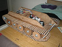 Name: P9280076.jpg Views: 186 Size: 65.5 KB Description: Both tracks finished with 44 oak guide teeth glued to centres of every other inside link, to keep the tracks on the wheels when turning.