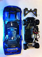Name: rs32 003.jpg Views: 240 Size: 108.2 KB Description: Note the magnets hot glued on end. Extra magnets are beside the car for size comparison. The battery cover in front of the car is no longer needed.