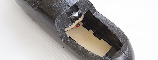 Inside the fuselage is a removable deck for electronics and a battery tray with slots for a hook-and-loop strap