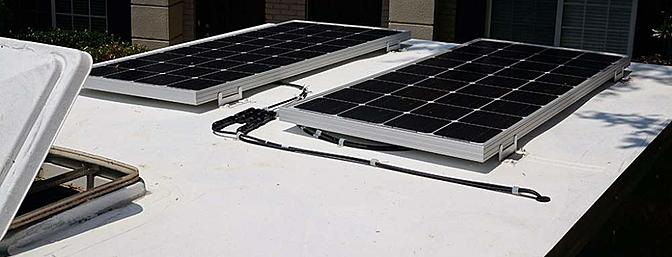 A pair of Renogy 100w panels on the roof of my 6x12 airplane hauler
