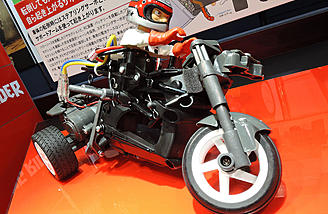 The Tamiya Dancing Rider Trike T3-01 has a front mounted battery and rear mounted motor