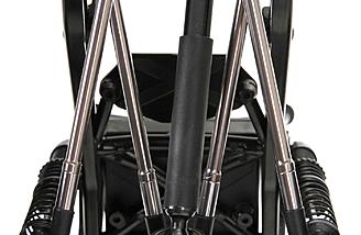 A 4-link rear suspension and 3-link front Panhard suspension connects to plastic axle housings and oil-filled threaded shocks.