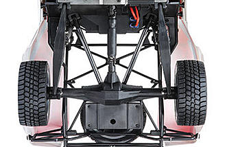 Rear 4-link long-travel arms over a solid axle.
